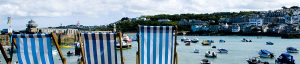 Stripy blue deckchairs overlooking the harbour at St Ives