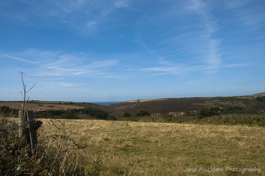 Countryside view to the sea at Porthtowan, Cornwall, across mining remains, by Jane Mucklow Photography