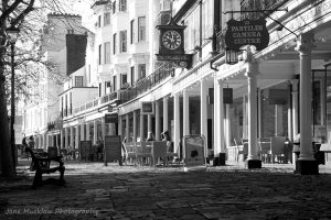 View along the Pantiles, showing the curve of the pillars, black and white photo by Jane Mucklow Photography