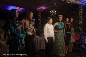 Photograph by Jane Mucklow of designer Josh Birch Jones and his models on the catwalk