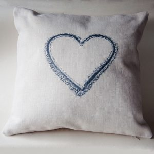 photo of a cream cushion printed in black with a heart shape, for sale by Jane Mucklow Photography