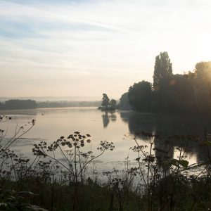Photograph of an Autumn misty sunrise over Chipstead Lake, Sevenoaks, by Jane Mucklow