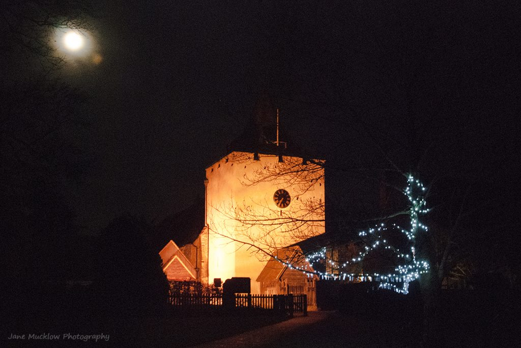 Photograph of St. Bart's, Otford at night, with a full moon and the Tree of Light, by Jane Mucklow