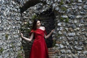 Photograph by Jane Mucklow of a red dress by Caroline Bruce