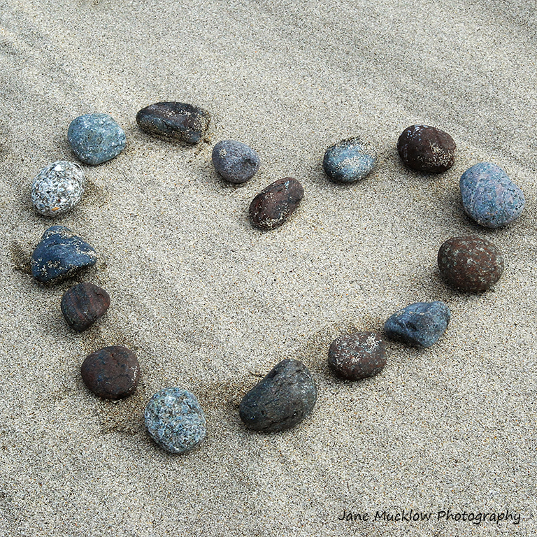 Photo of a heart shape made from pebbles on a beach by Jane Mucklow, Valentine's card design