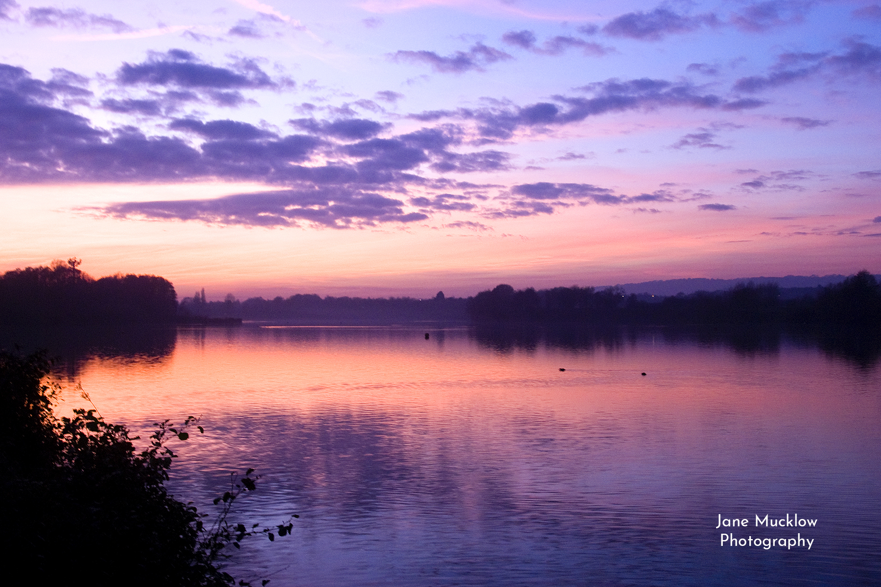 Photo of a winter sunset over Chipstead Lake, Sevenoaks, by Jane Mucklow