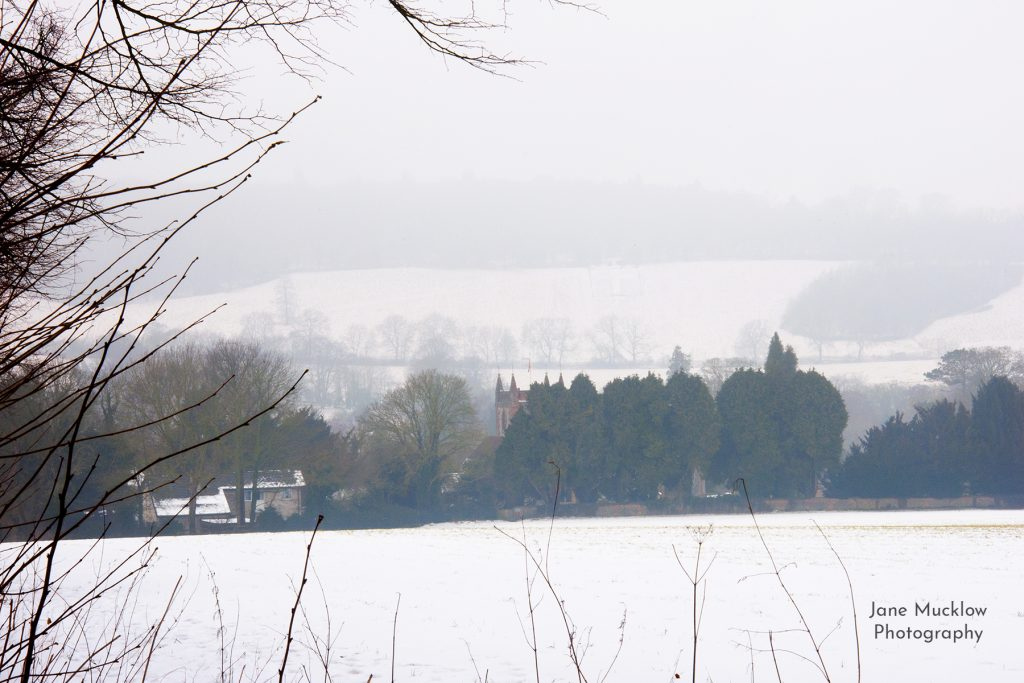 Photo of Shoreham in the snow, view across the church to Shoreham Cross,, by Jane Mucklow