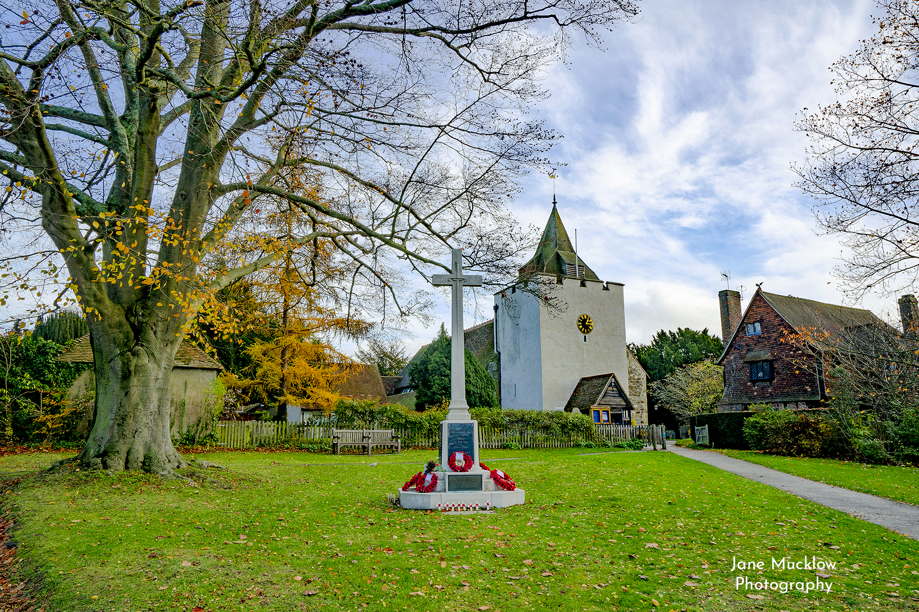 Photo of St. Bart's and the war memorial with poppies, by Jane Mucklow