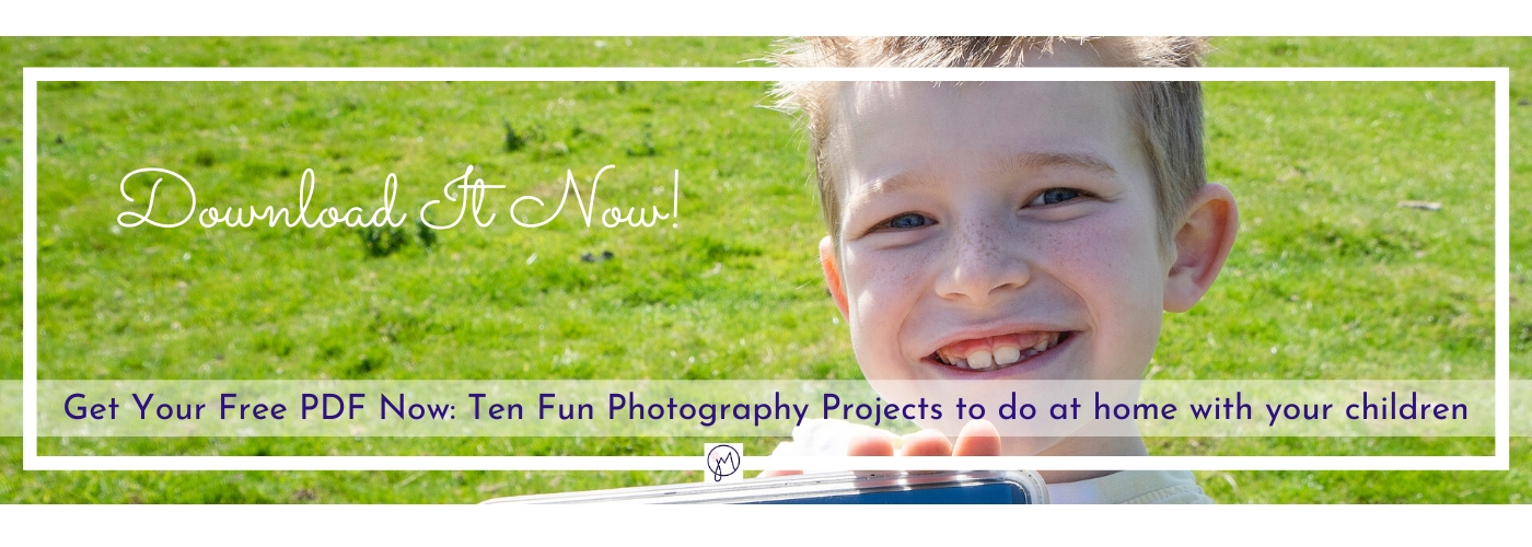 Photo of a smiling boy with a mobile phone, image for download of photography projects for children by Jane Mucklow Photography