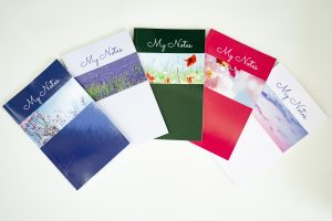 Photograph by Jane Mucklow of her set of five notebooks with her photos on the covers