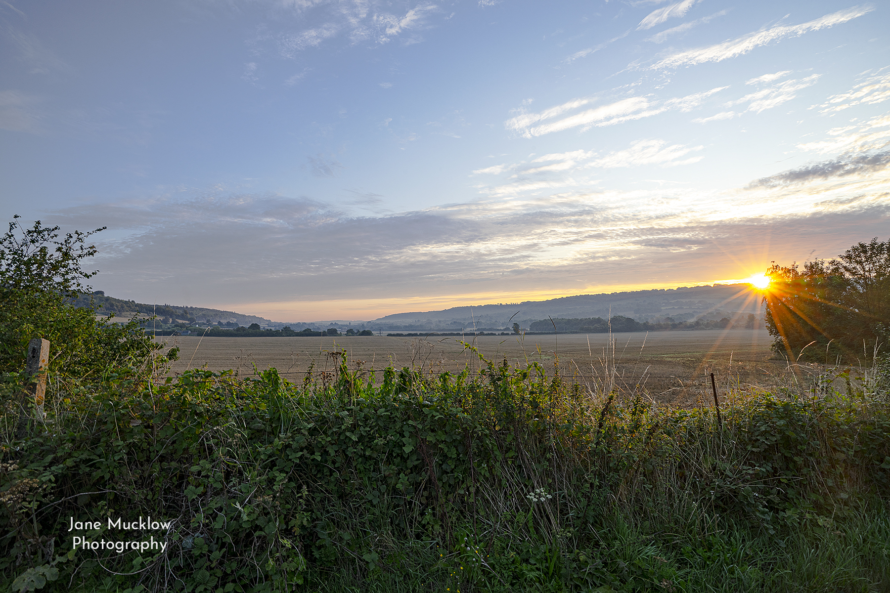 Photograph by Jane Mucklow of the sunrise over Otford Mount, view towards Shoreham