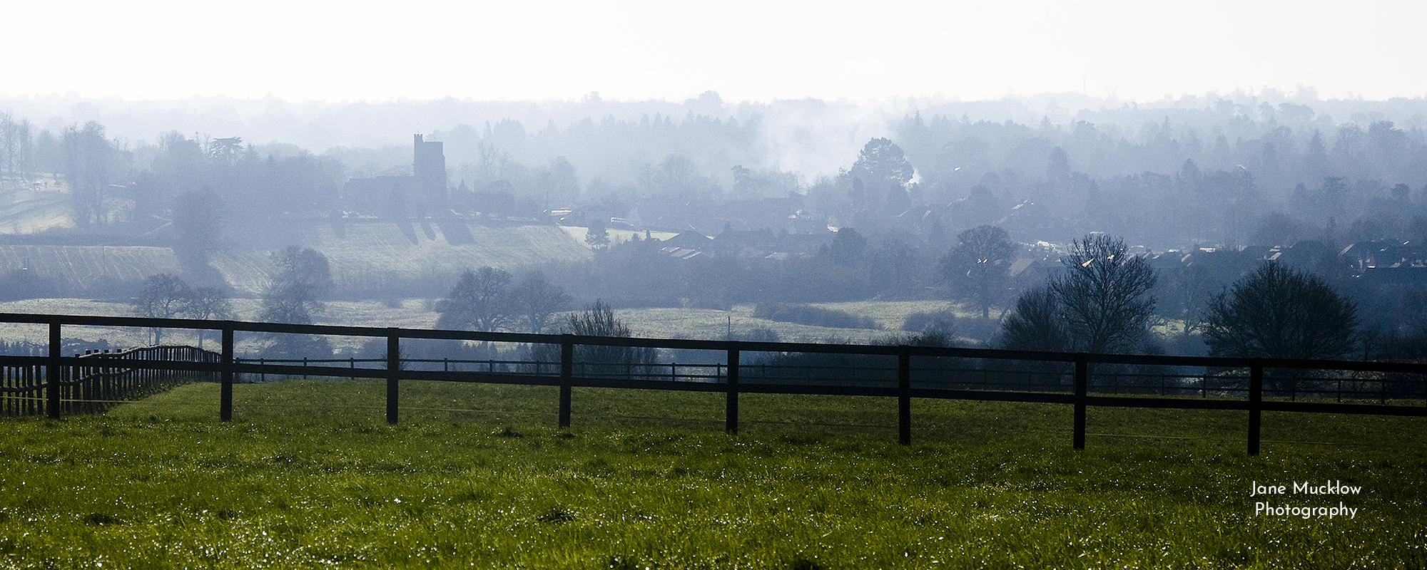 Photo by Jane Mucklow of a misty sunrise view from Kemsing to Seal and Sevenoaks, Kent, available as a canvas for your wall.