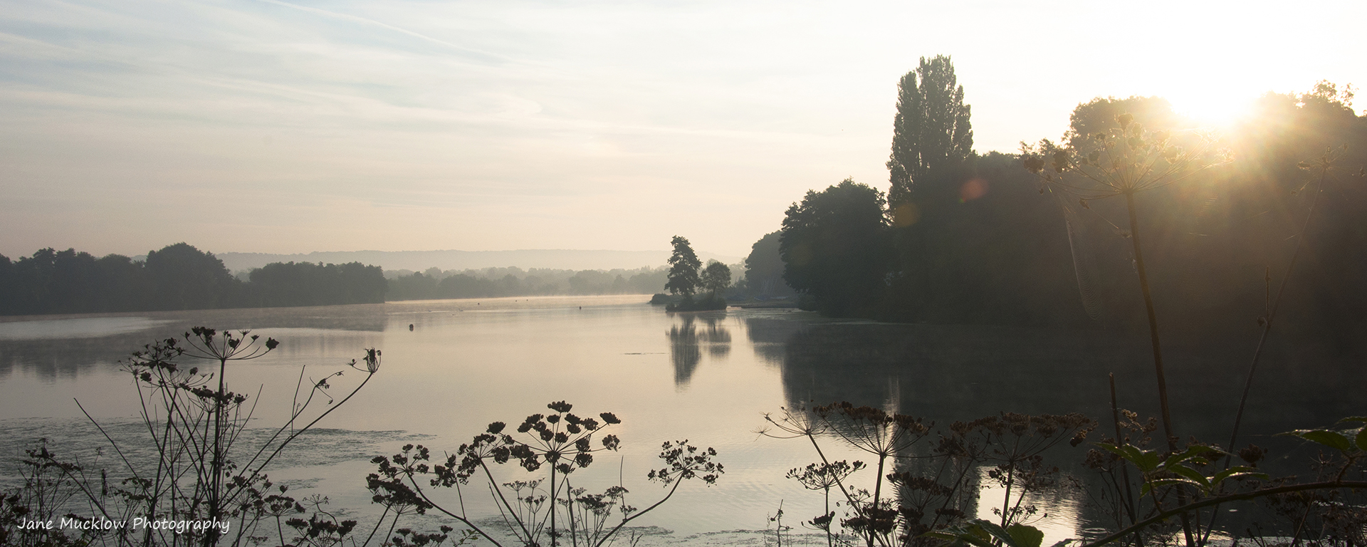 Photo by Jane Mucklow of a misty sunrise over Chipstead Lake, Sevenoaks, Kent, available as a canvas for your wall.