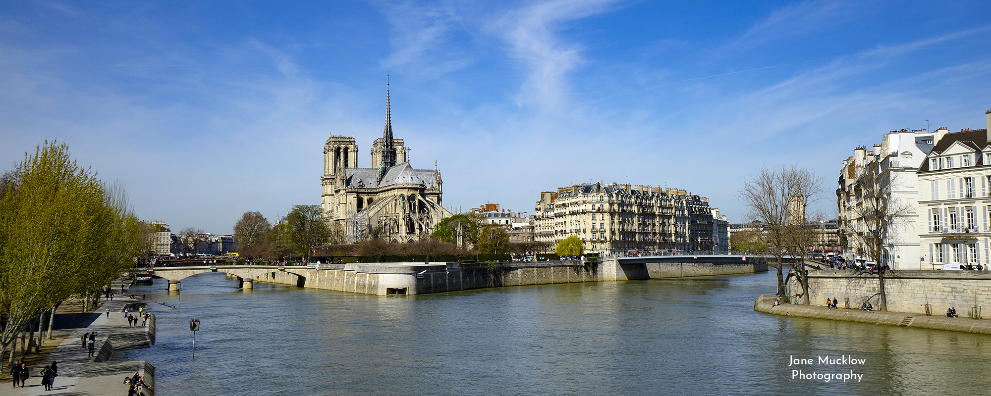 Photo by Jane Mucklow of the River Seine in Paris, with a view of Notre Dame, available as a canvas for your wall.