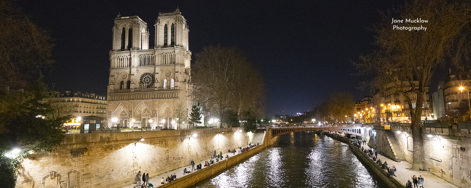 Photo by Jane Mucklow of Notre Dame and the River Seine in Paris, at night, available as a canvas for your wall.