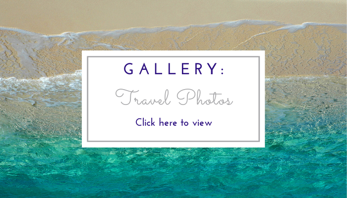 Photo by Jane Mucklow of a tropical turquoise sea and beach, website page button for the travel photo gallery
