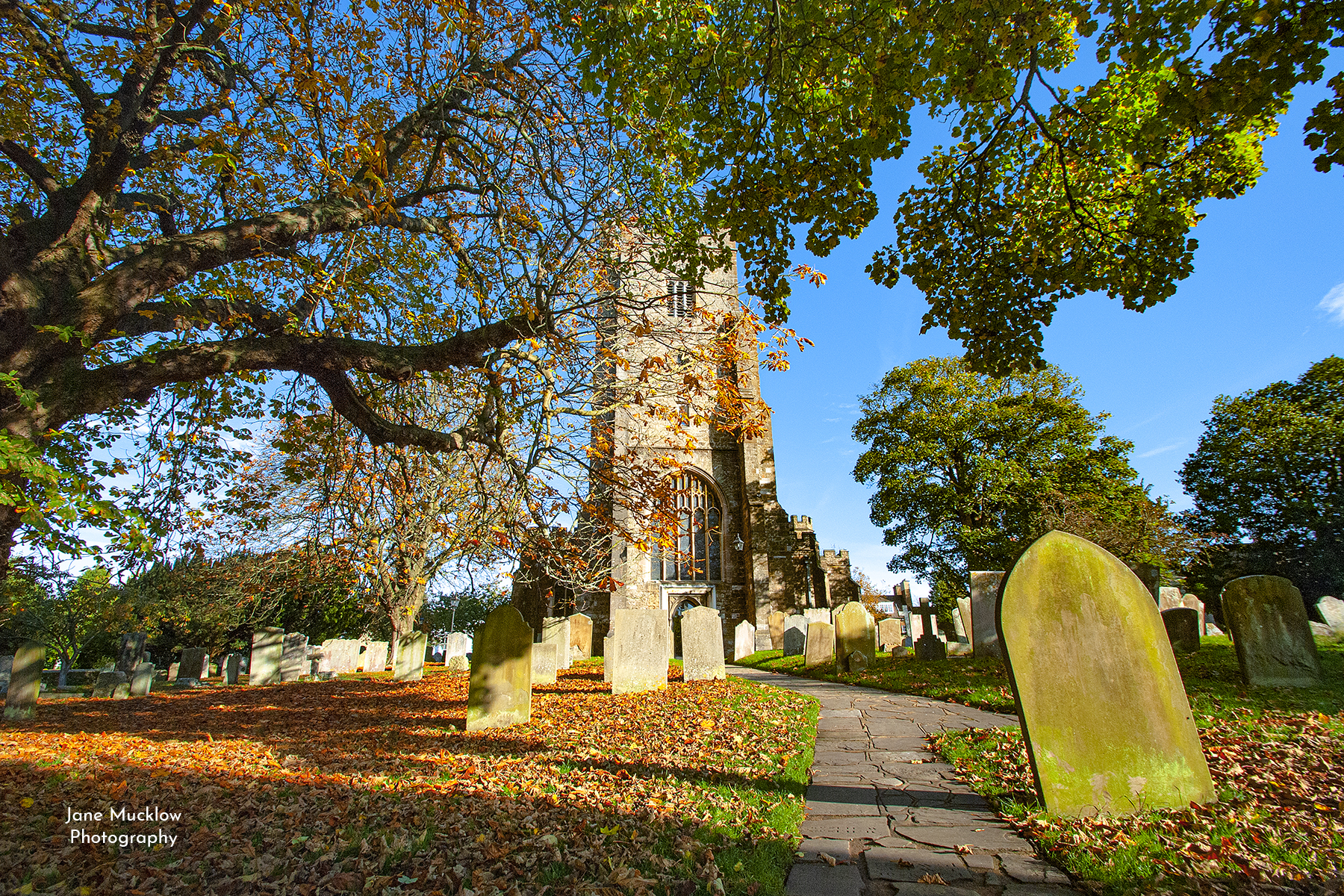 Photograph by Jane Mucklow of St. Nick's church in Sevenoaks, Kent, with Autumn trees.