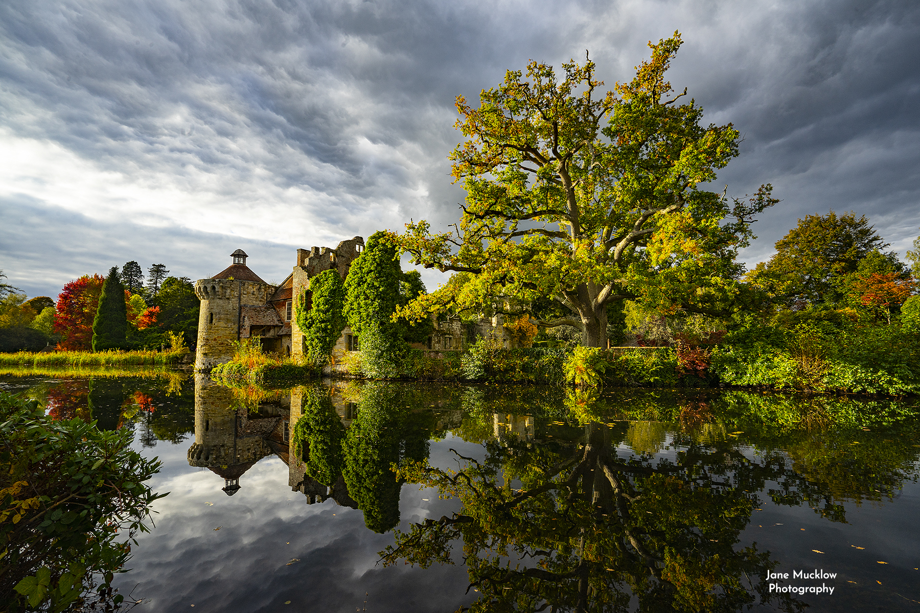 Photo of Autumn stormy reflections at Scotney Castle Kent by Jane Mucklow