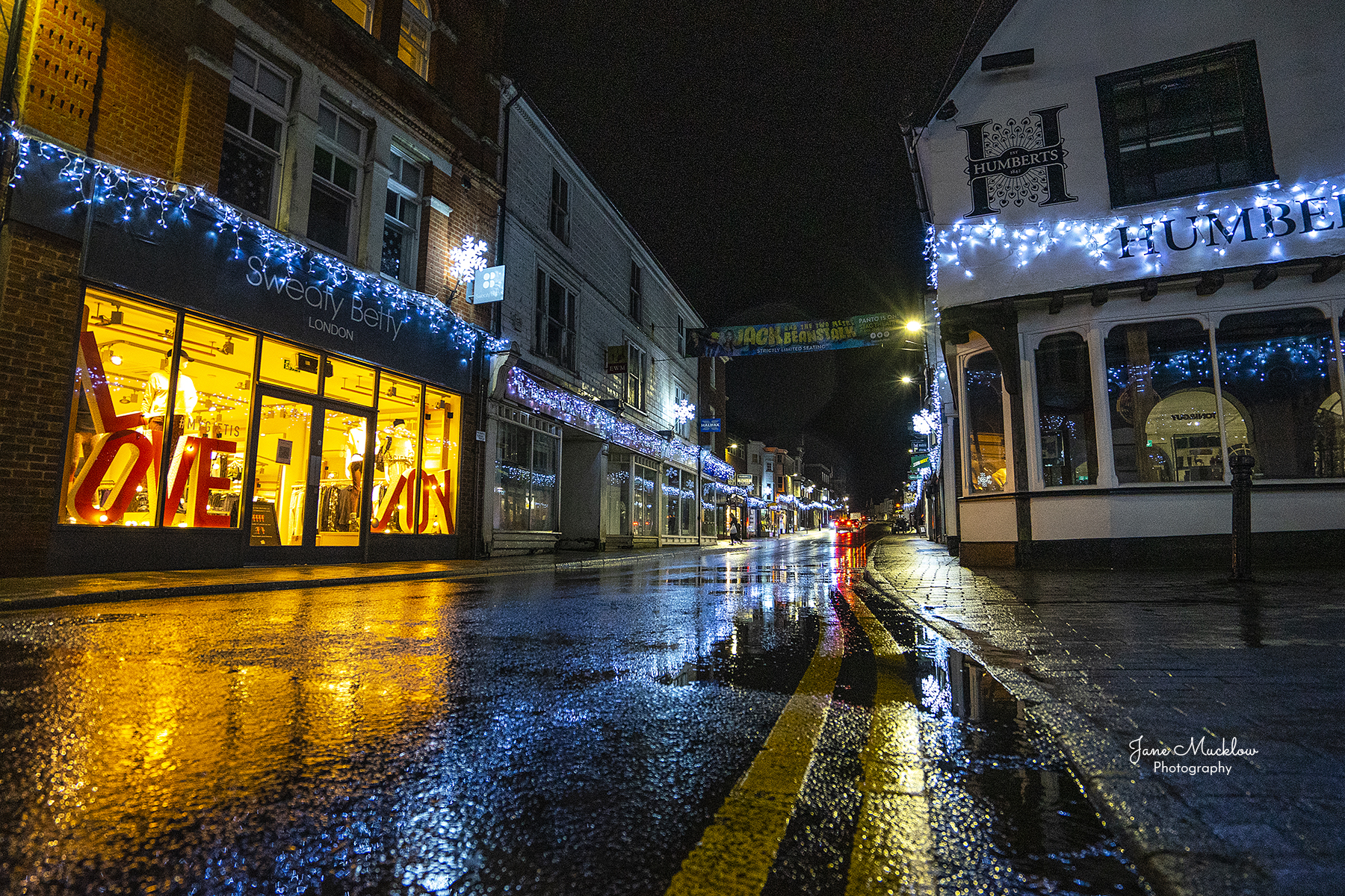 Photo of the Christmas lights on a wet evening in Sevenoaks high street, by Jane Mucklow