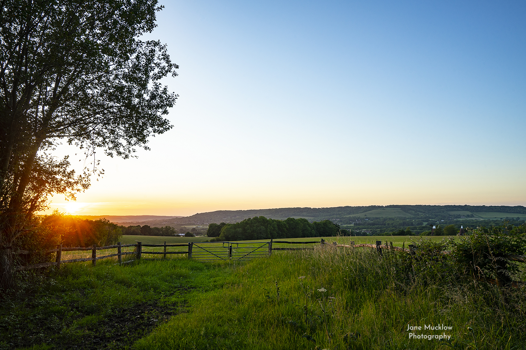 Photo of the view at sunset from Seal Chart towards Kemsing and Otford, by Jane Mucklow